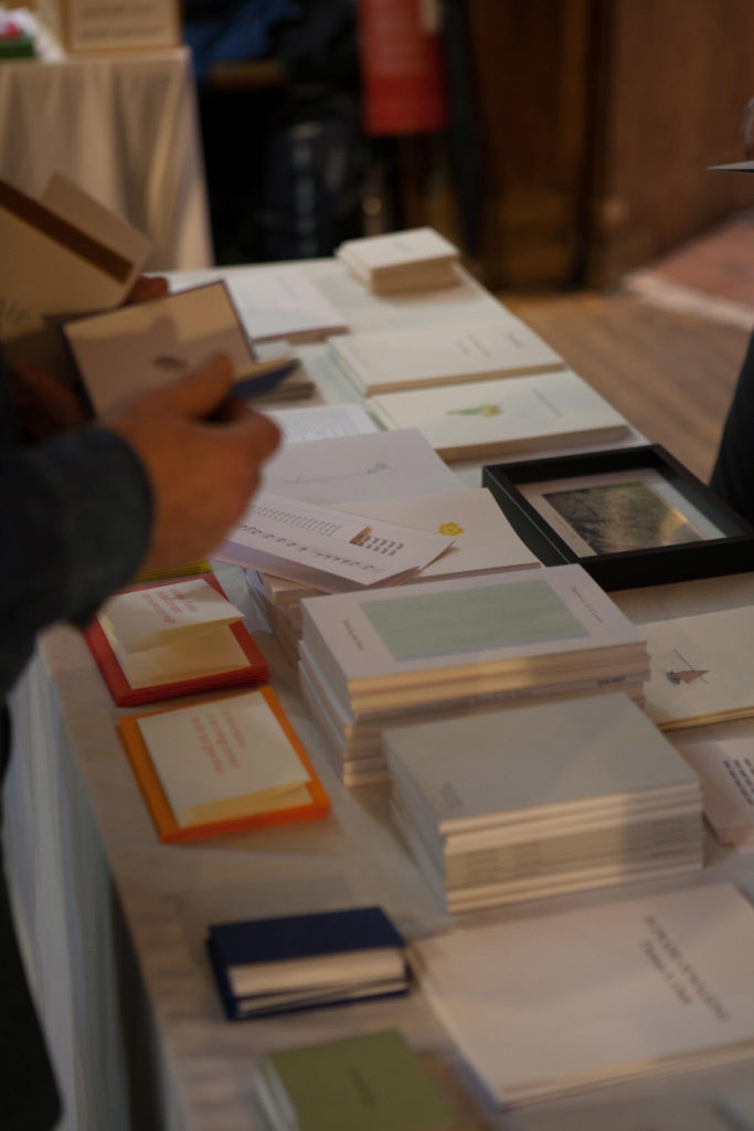 Photograph of the Moschatel Press table at Small Publishers Fair 2018. Many books, pamphlets and someone reading one of the small books.